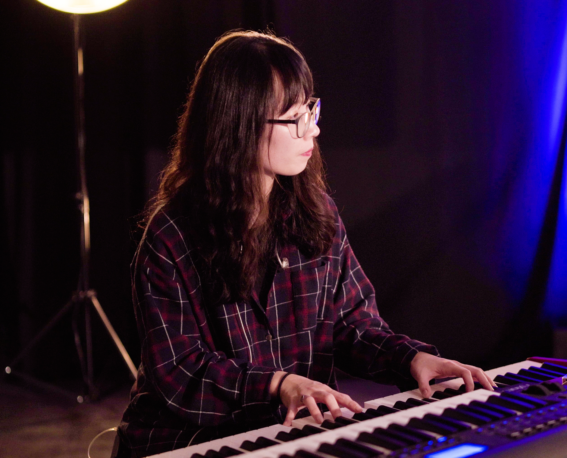 YWAMer playing the piano during worship